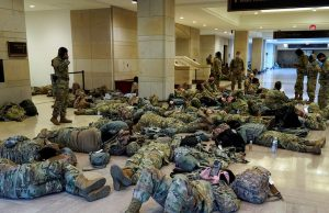 Exhausted US National Guards sleep on Capitol floor with their weapon by their side || PEAKVIBEZ